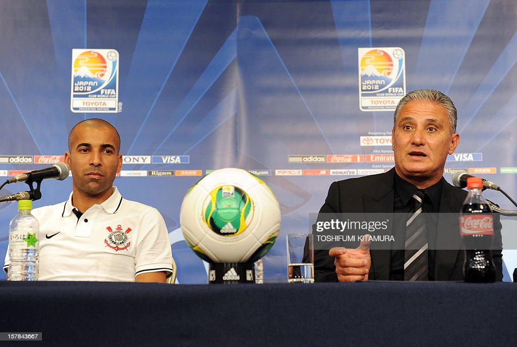 Brazilian club team Corinthians head coach Tite answers a question beside his team's captain and forward Emerson (L) during their press conference at a hotel in Nagoya, Aichi prefecture while participating in the FIFA Club World Cup in Japan 2012 on December 7, 2012. The ninth edition of the FIFA Club World Cup football tournament is taking place from December 6 to 16. AFP PHOTO / TOSHIFUMI KITAMURA