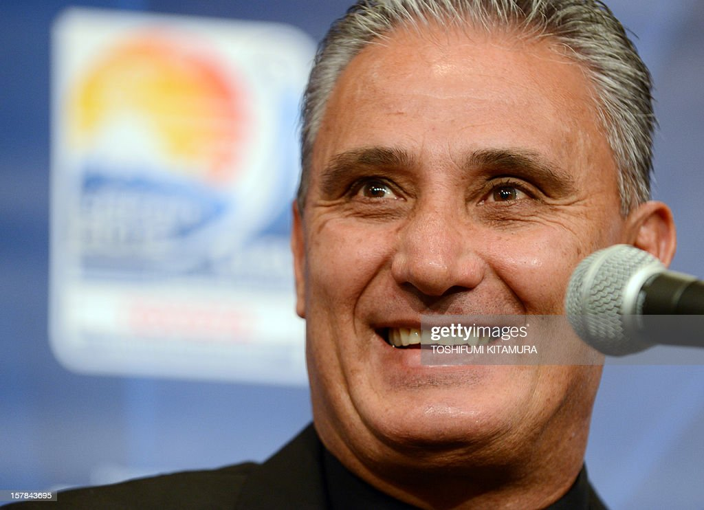 Brazilian club team Corinthians head coach Tite smiles during their press conference at a hotel in Nagoya, Aichi prefecture while participating in the FIFA Club World Cup in Japan 2012 on December 7, 2012. The ninth edition of the FIFA Club World Cup football tournament is taking place from December 6 to 16.