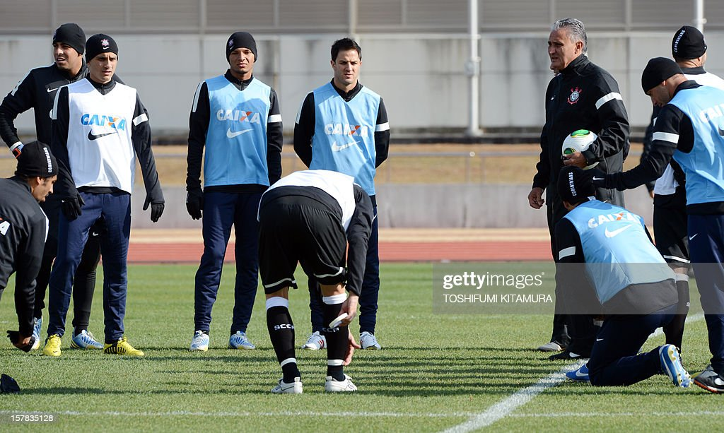 Brazilian club team Corinthians head coach Tite (4th R) speaks to his players during a team training session in Kariya, Aichi prefecture while participating in the FIFA Club World Cup in Japan 2012 on December 7, 2012. The ninth edition of the FIFA Club World Cup football tournament is taking place from December 6 to 16.
