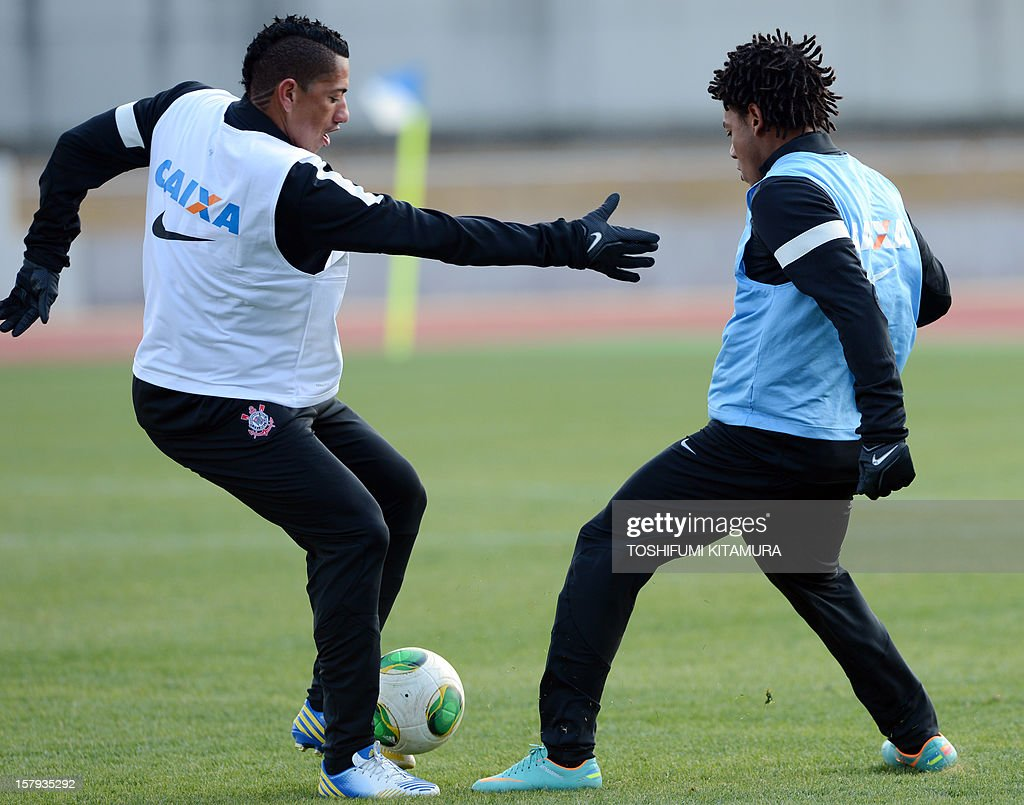 Brazilian club team Corinthians midfielder Ralf (L) fights for the ball with forward Romarinho (R) during the team's training session in Kariya, Aichi prefecture on December 8, 2012 while participating in the FIFA Club World Cup in Japan 2012. The ninth edition of the FIFA Club World Cup football tournament is taking place from December 6 to 16.