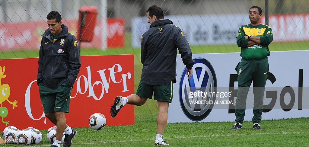 Brazilian coach Dunga (C) controls the ball during a training session in Curitiba, southern Brazil on May 24, 2010. Brazil, five-time world champion, is among the favourites for the South Africa 2010 World Cup which starts on June 11th. The 'Selecao' have been drawn in Group G with North Korea, Ivory Coast and Portugal.