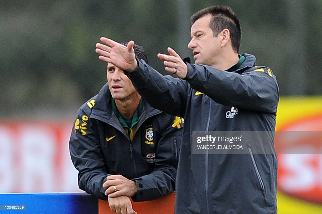 Brazilian coach Dunga (R) gestures with assistent coach Jorginho during a training session in Curitiba, southern Brazil on May 24, 2010. Brazil, five-time world champion, is among the favourites for the South Africa 2010 World Cup which starts on June 11th. The 'Selecao' have been drawn in Group G with North Korea, Ivory Coast and Portugal.
