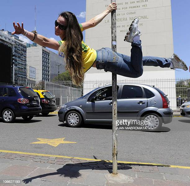 A Brazilian competitor of the Miss Pole Dance Sudamerica 2010 performs in front of the Obelisk in downtown Buenos Aires on November 5 on the eve of...