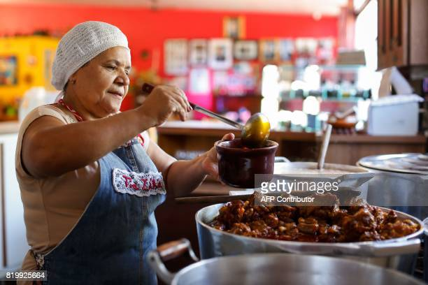 Brazilian cook Tia Zelia one of former president Luiz Inacio Lula da Silva's favorite cooks prepares 'oxtail' a typical dish from the northeastern...