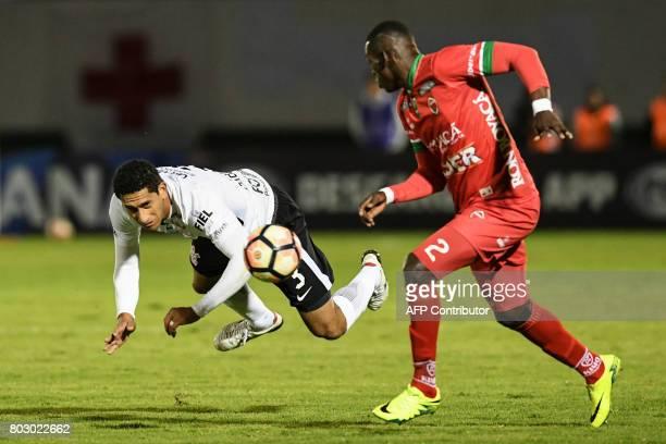 Brazilian Corinthians defender Pablo Castro vies for the ball with Colombian Patriotas defender Jesus Murillo during their Copa Sudamericana football...
