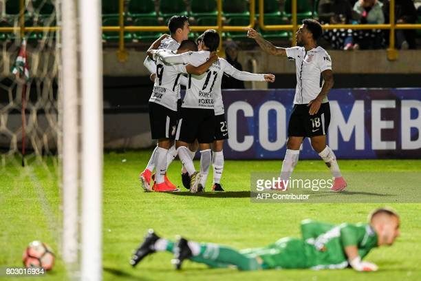 Brazilian Corinthians defender Paraguayan Fabian Balbuena celebrates with his teammates after scoring against Colombian Patriotas during their Copa...