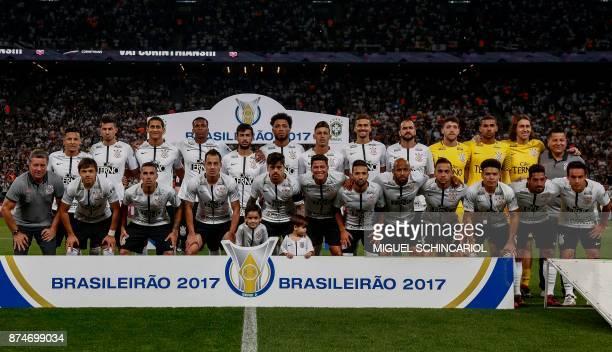 Brazilian Corinthians team poses before the 2017 Brazilian championship football match against Fluminense at the Arena Corinthians Stadium in Sao...