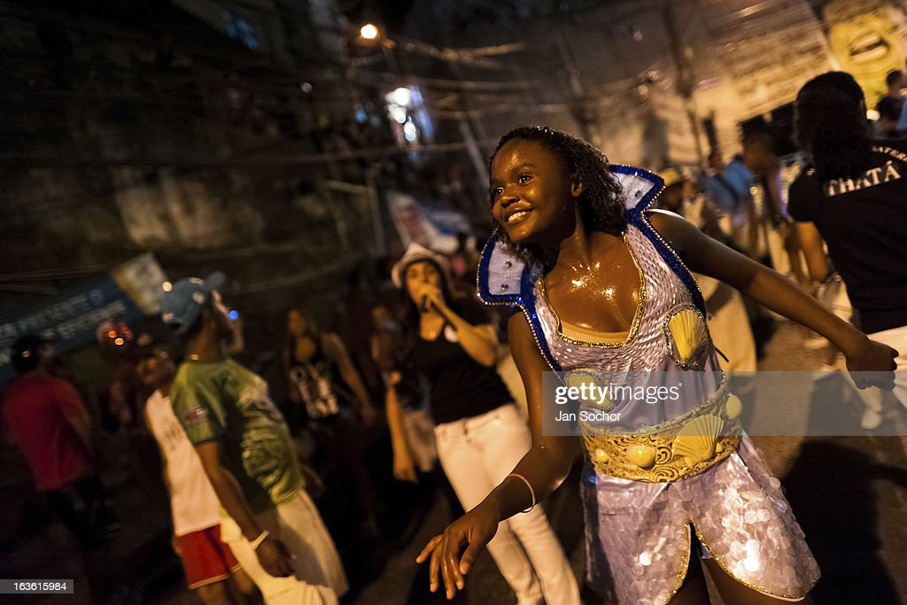 Brazilian dancer performs during the Carnival parade in the favela of Rocinha, on 20 February 2012 in Rio de Janeiro, Brazil. Rocinha, the largest shanty town in Brazil and one of the most developed in Latin America, has its own samba school called GRES Academicos da Rocinha. The Rocinha samba school is very loyal to its neighborhood. Throughout the year, the entire community actively participate in rehearsals, culture events and parades related to the carnival.