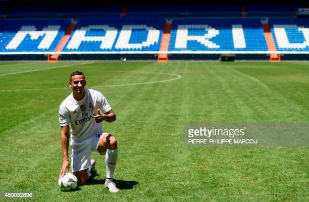 Brazilian Danilo gives a thumbs up as he poses for photographers during his presentation as new player of Real Madrid Football Club at Santiago...