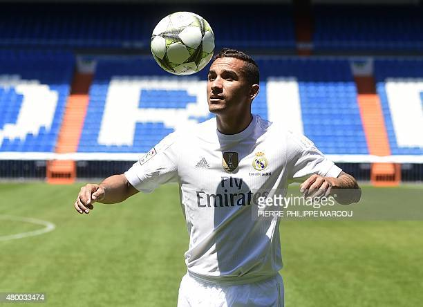 Brazilian Danilo plays with the ball during his presentation as new player of Real Madrid Football Club at Santiago Bernabeu stadium in Madrid on...