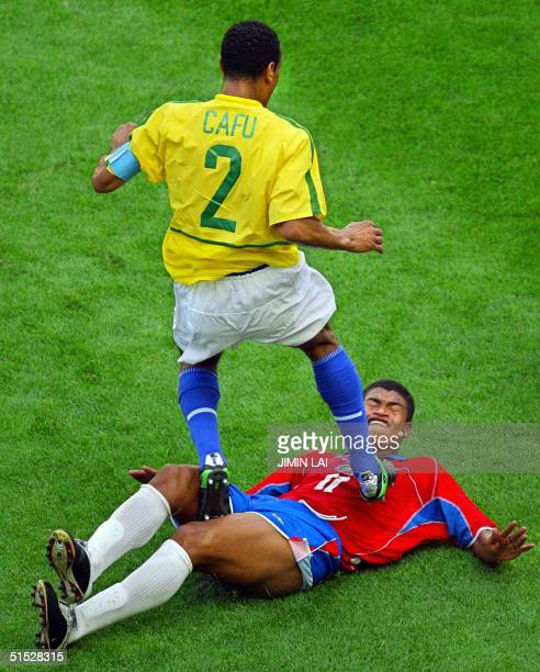 Brazilian defender Cafu steps on Costa Rican forward Ronald Gomez during their Group C match at the 2002 FIFA World Cup Korea/Japan in Suwon 13 June...
