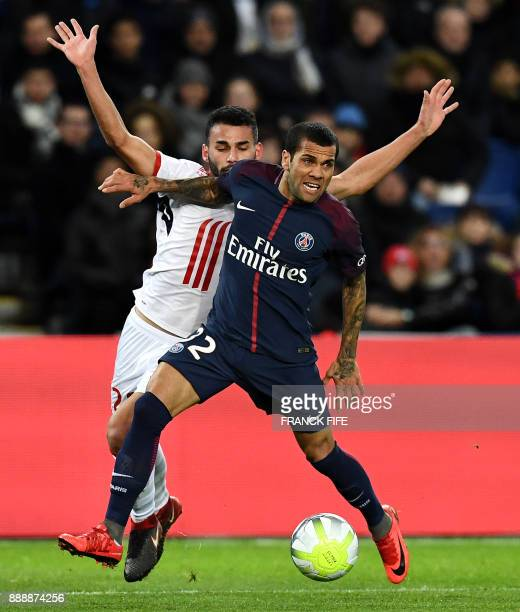 Brazilian defender Dani Alves outruns Lille's Brazilian midfielder Thiago Maia during the French L1 football match between Paris SaintGermain and...