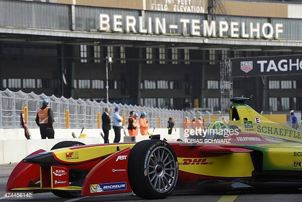 Brazilian driver Lucas Di Grassi of the Audi Sport ABT team drives past the building of the former Tempelhof airport during a practise session of the...