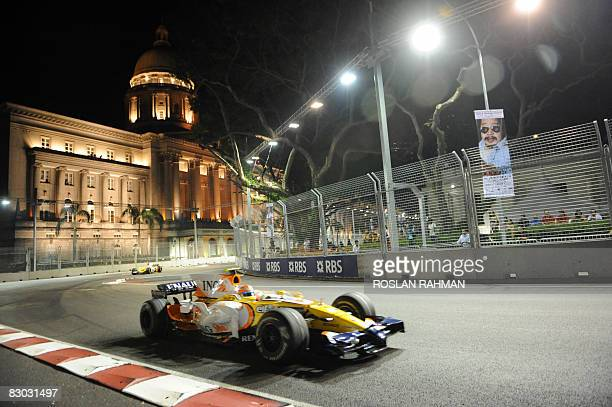 Brazilian driver Nelson Piquet of team Renault take a corner during the final practice session at the Singapore Grand Prix on September 27 2008 ahead...