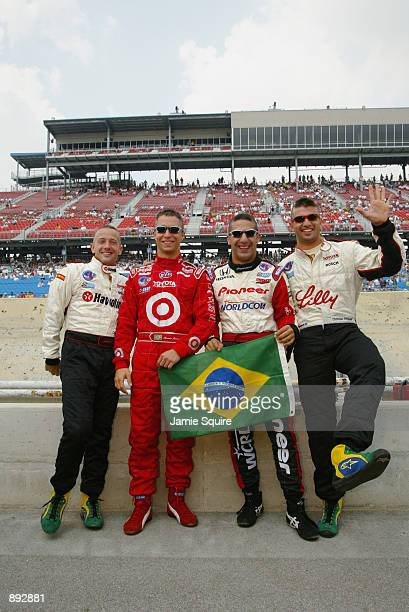 Brazilian drivers Cristiano da Matta Bruno Junqueira Tony Kanaan and Christian Fittipaldi display their support for their soccer World Cup winning...