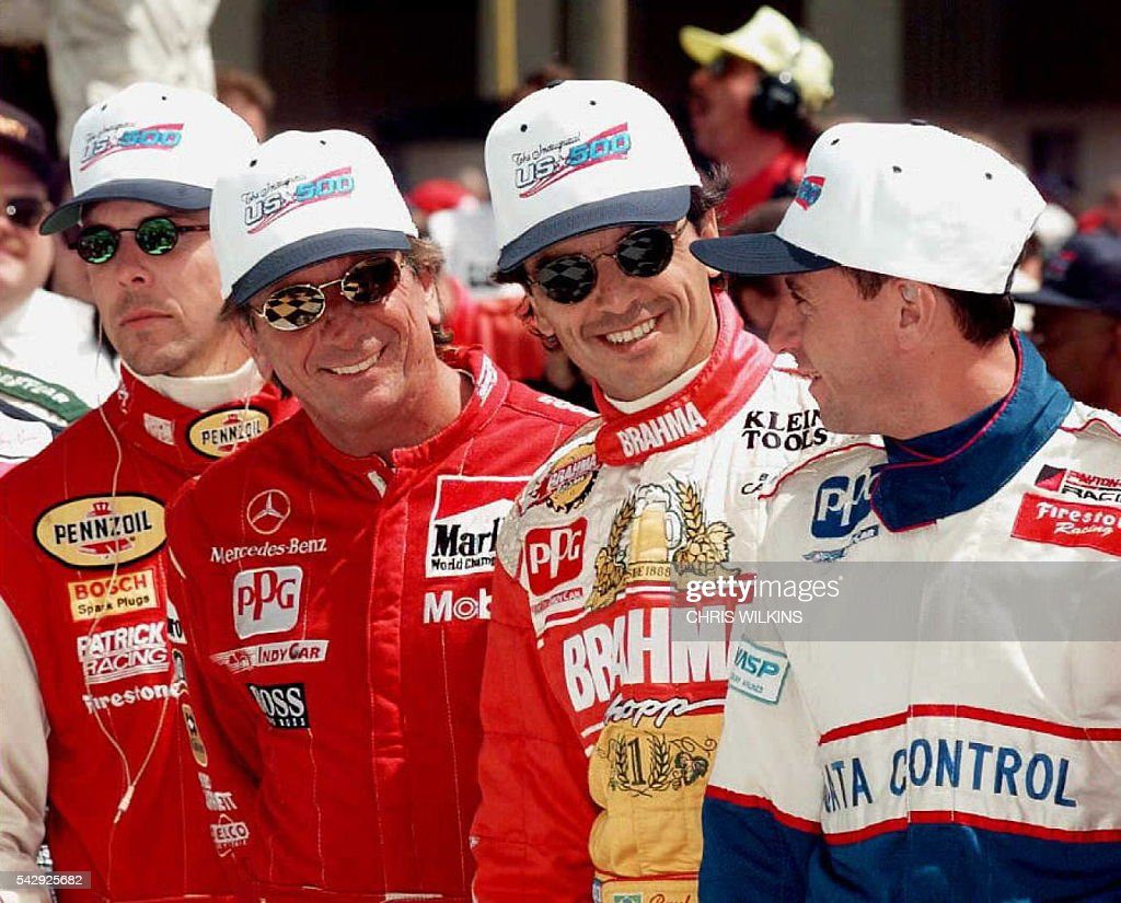 Brazilian drivers Emerson Fittipaldi Raul Boesel and Roberto Moreno are joined by US driver Scott Pruitt as they get in line 25 May for the official...