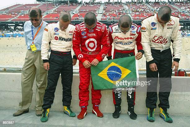 Brazilian drivers Roberto MorenoCristiano da Matta Bruno Junqueira Tony Kanaan and Christian Fittipaldi display their support for their soccer World...