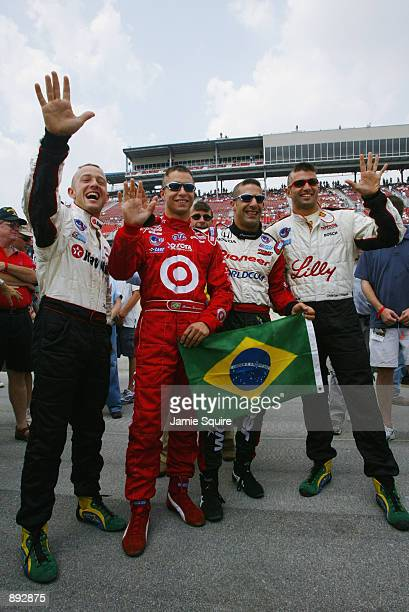 Brazilian driversCristiano da Matta Bruno Junqueira Tony Kanaan and Christian Fittipaldi display their support for their soccer World Cup winning...