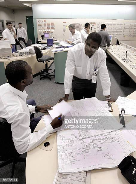 Brazilian engineers study blueprints at Angra 2 nuclear plant's controlroom 25 November 2005 in Itaorna 250 Km south of Rio de Janeiro Brazil An...