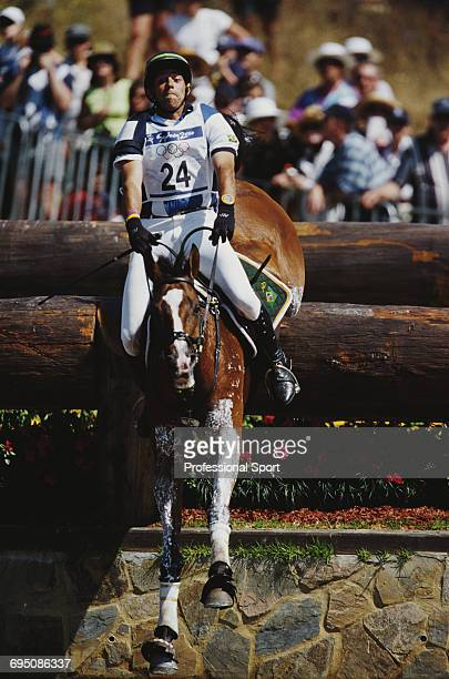 Brazilian equestrian Eder Pagota competes on Amazonia for the Brazil team to finish in 6th place in the Team eventing equestrian event at the 2000...