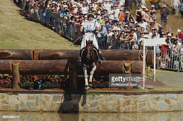 Brazilian equestrian Vincente Araujo competes on Teveri for the Brazil team to finish in 6th place in the Team eventing equestrian event at the 2000...