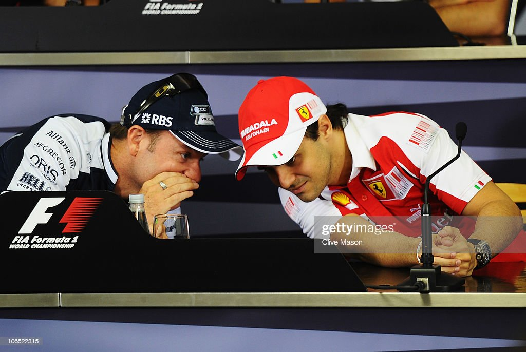 Brazilian F1 drivers Rubens Barrichello of Williams and Felipe Massa of Ferrari talk as they attend the drivers press conference during previews to the Brazilian Formula One Grand Prix at the Interlagos Circuit on November 4, 2010 in Sao Paulo, Brazil.