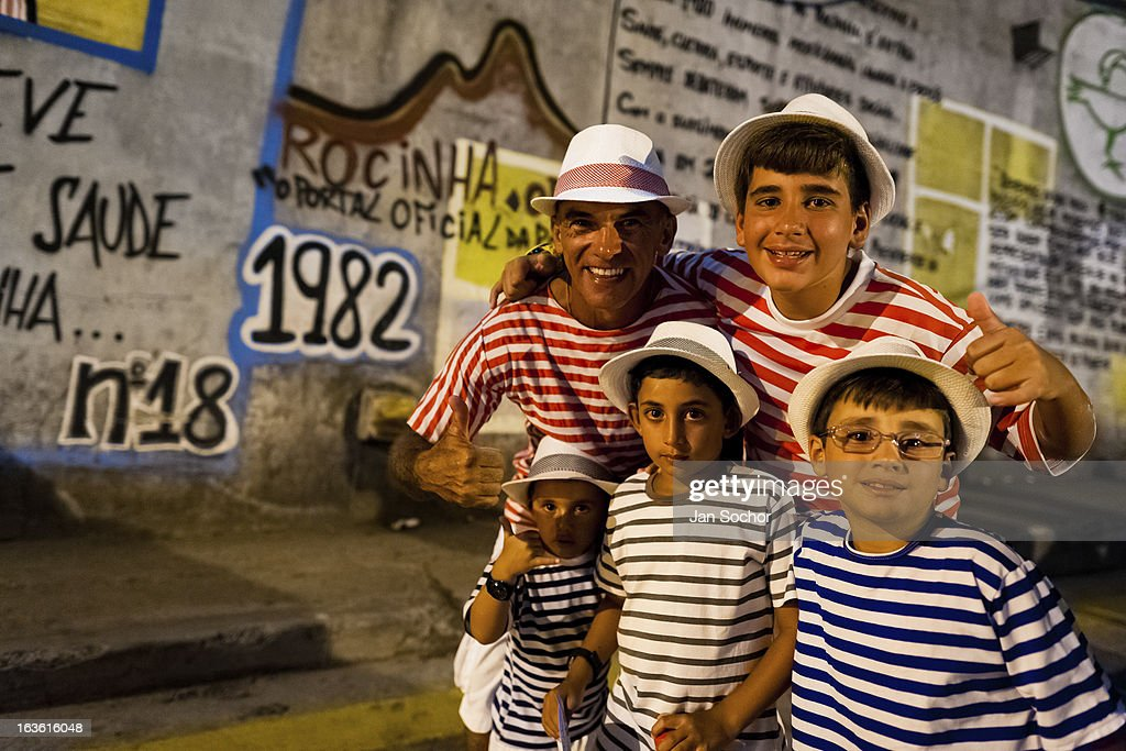 Brazilian family, all wearing striped t-shirts, take part in the Carnival parade in the favela of Rocinha, on 20 February 2012 in Rio de Janeiro, Brazil. Rocinha, the largest shanty town in Brazil and one of the most developed in Latin America, has its own samba school called GRES Academicos da Rocinha. The Rocinha samba school is very loyal to its neighborhood. Throughout the year, the entire community actively participate in rehearsals, culture events and parades related to the carnival.