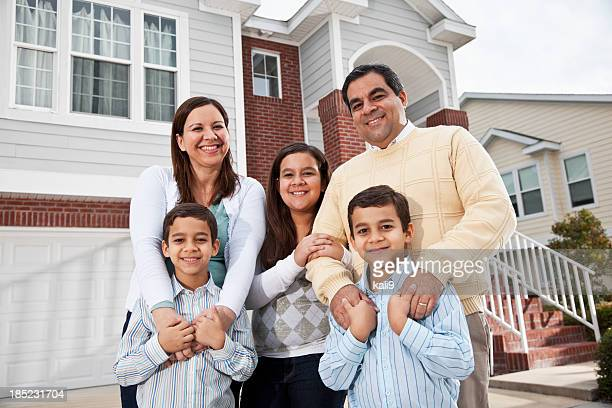 Brazilian family in front of house