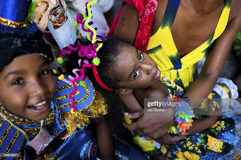 Brazilian family, wearing colorful costumes, take part in the Carnival parade in the favela of Rocinha, on 20 February 2012 in Rio de Janeiro, Brazil. Rocinha, the largest shanty town in Brazil and one of the most developed in Latin America, has its own samba school called GRES Academicos da Rocinha. The Rocinha samba school is very loyal to its neighborhood. Throughout the year, the entire community actively participate in rehearsals, culture events and parades related to the carnival.