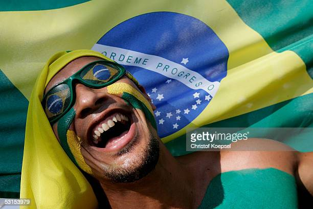 Brazilian fan celebrates before the Semi Final Match between Germany and Brazil for the FIFA Confederations Cup 2005 at the Franken Stadium on June...