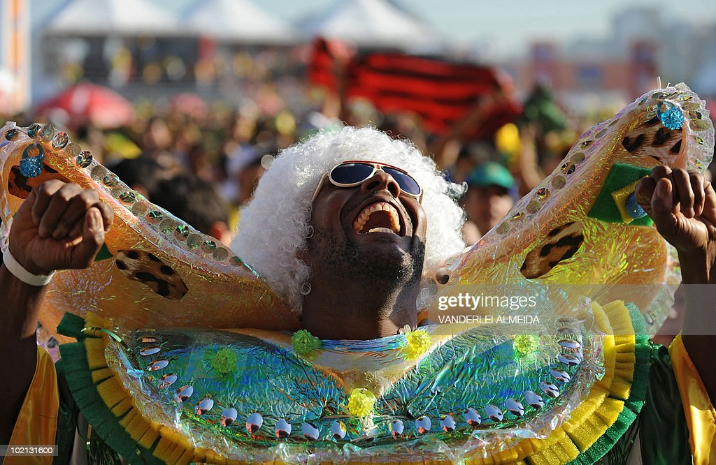 A Brazilian fan celebrates the goal against North Korea as he watches the FIFA World Cup South Africa 2010 football match on a giant screen in Copacabana beach, in Rio de Janeiro, Brazil on June 15, 2010.