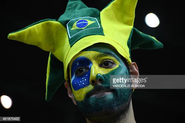 A Brazilian fan reacts after the semifinal football match between Brazil and Germany at The Mineirao Stadium in Belo Horizonte during the 2014 FIFA...