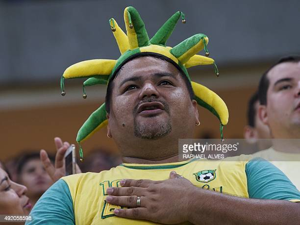 A Brazilian fan sings the national anthem before the start of the U23 friendly football match between Brazil and the Dominican Republic held at the...