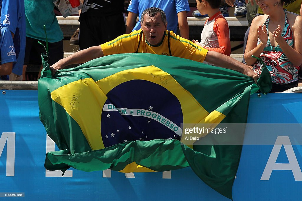 A Brazilian fan waves a flag during the Men's Beach Volleyball Final between Brazil and Venezuela at the Beach Volleyball Stadium on October 22, 2011 in Puerto Vallarta, Mexico.