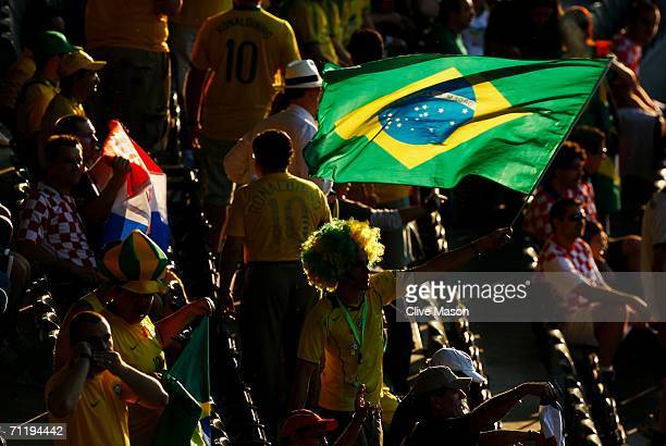 Brazilian fan waves his flag prior to the FIFA World Cup Germany 2006 Group F match between Brazil and Croatia played at the Olympic Stadium on June...