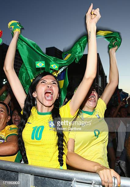 Brazilian fans celebrate after Brazil defeated Uruguay in the Confederations Cup semi final on June 26 2013 at the FIFA Fan Fest Fortaleza Brazil