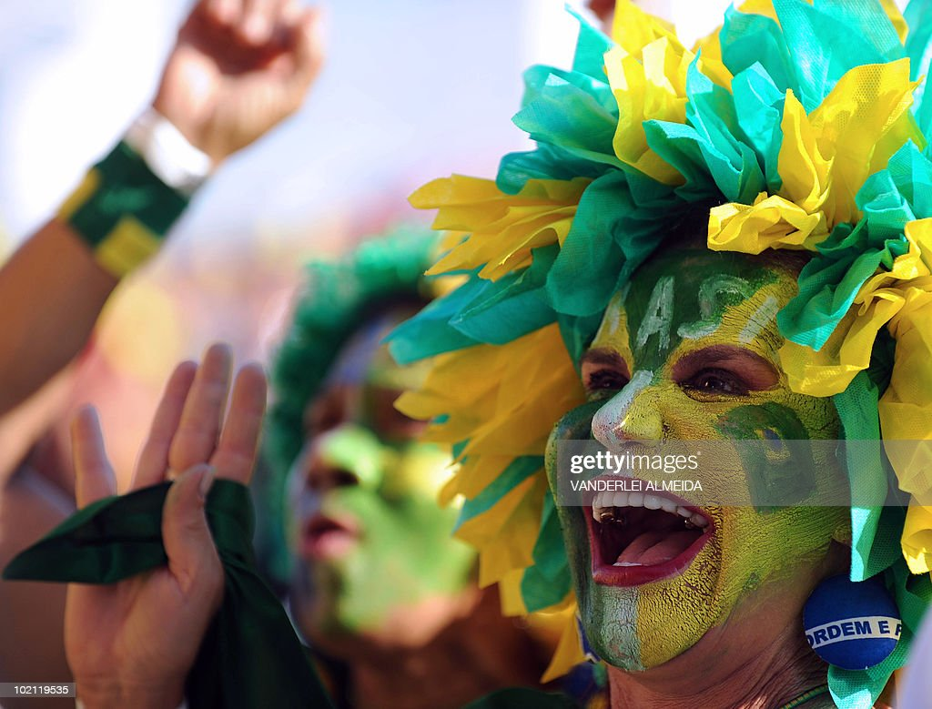 Brazilian fans celebrate their goal agai