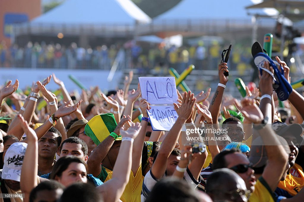 Brazilian fans celebrate their goal against North Korea as they watch the FIFA World Cup South Africa 2010 football match on a giant screen in Copacabana beach, in Rio de Janeiro, Brazil on June 15, 2010.