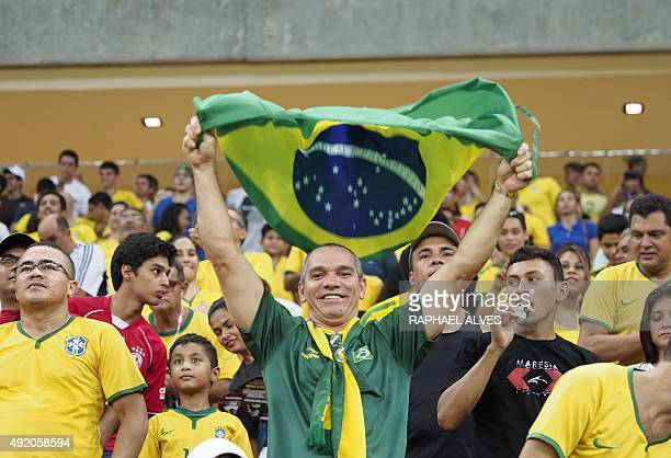Brazilian fans cheer before the start of the U23 friendly football match between Brazil and the Dominican Republic held at the Amazonia Arena in...