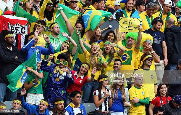 Brazilian fans cheer during the Men's Football first round Group C match between Brazil and New Zealand on Day 5 of the London 2012 Olympic Games at...