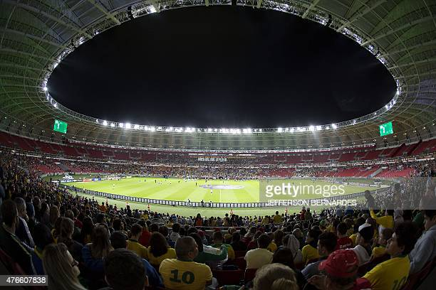 Brazilian fans cheer for their team before the start of a friendly football match against Honduras in preparation for the upcoming Copa America Chile...
