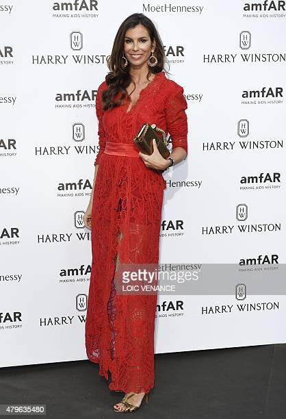 Brazilian fashion buyer Christina Pitanguy poses as she arrives for the amfAR dinner on the sidelines of the Paris fashion week in Paris on July 5...