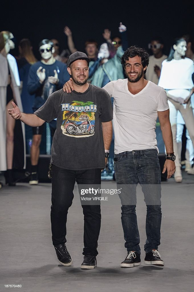 Brazilian fashion designer Ricardo Brautigam (L) walks the runway during the Auslander show as part of the Rio de Janeiro Fashion Week Fall/Winter 2014 on November 9, 2013 in Rio de Janeiro, Brazil.
