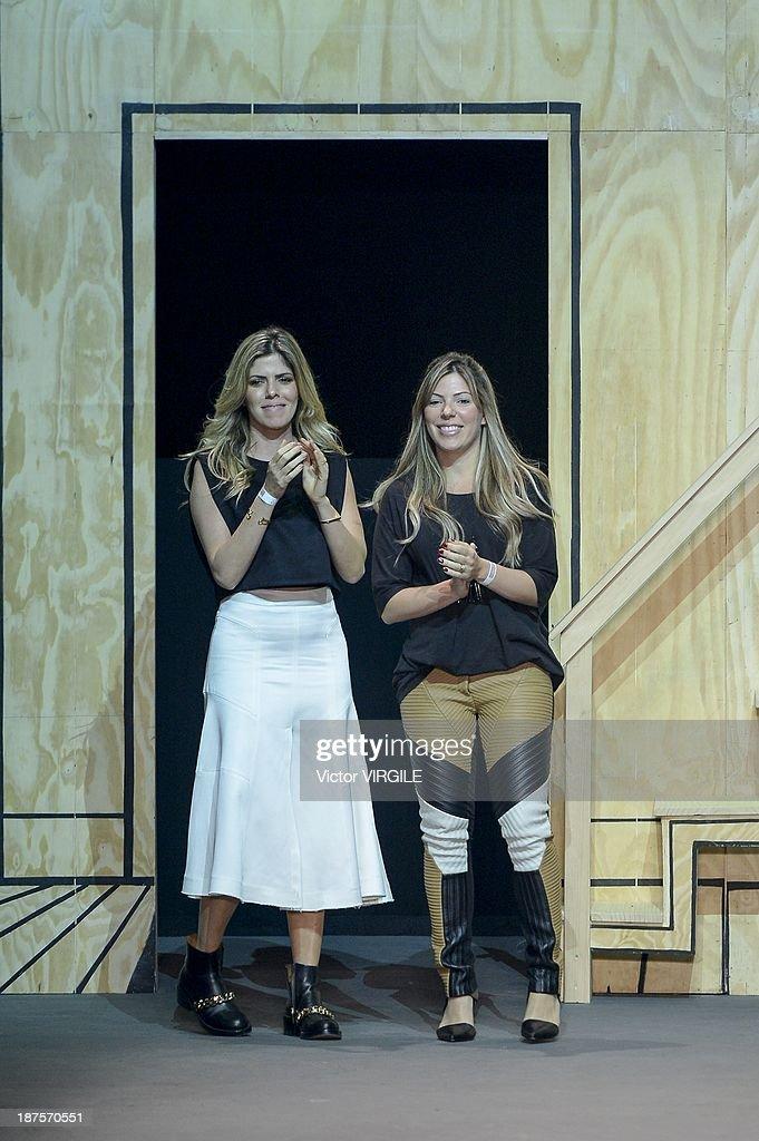 Brazilian fashion designers and sisters Camilla and Bianca Bastos during the Espaco show as part of the Rio de Janeiro Fashion Week Fall/Winter 2014 on November 9, 2013 in Rio de Janeiro, Brazil.
