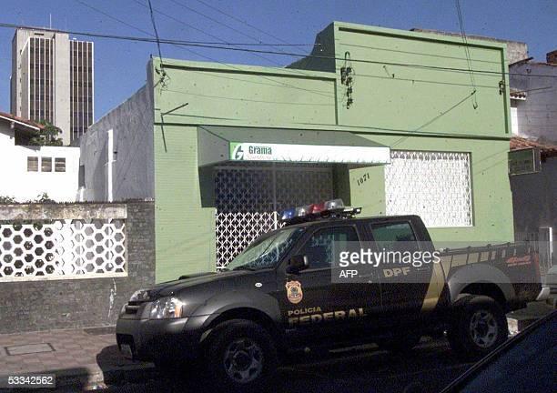 Brazilian Federal Police car remains parked in front of the house from where the Central Bank robbers dug their tunnel 08 August in Fortaleza...