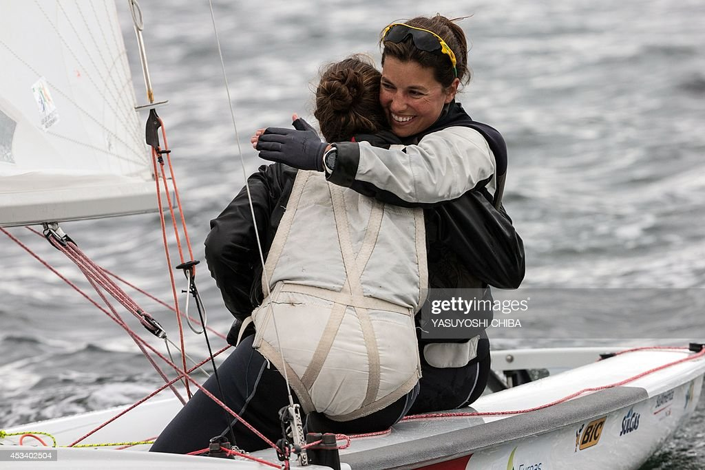 Brazilian Fernanda Oliveira and Ana Barbachan celebrate after finishing in the fifth place in the Women's 470 competition during the final day of...
