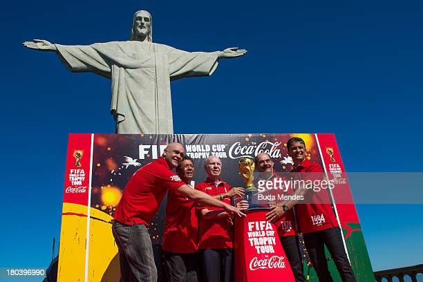 Brazilian FIFA World Cup winners Marcos Amarildo Zagallo Rivelino and Bebeto pose with the trophy during the official launch of the Global FIFA World...