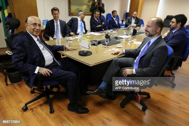 Brazilian Finance Minister Henrique Meirelles and the UBER's CEO Dara Khosrowshahi meet in Brasilia Brazil on October 31 2017 PHOTO / Sergio LIMA