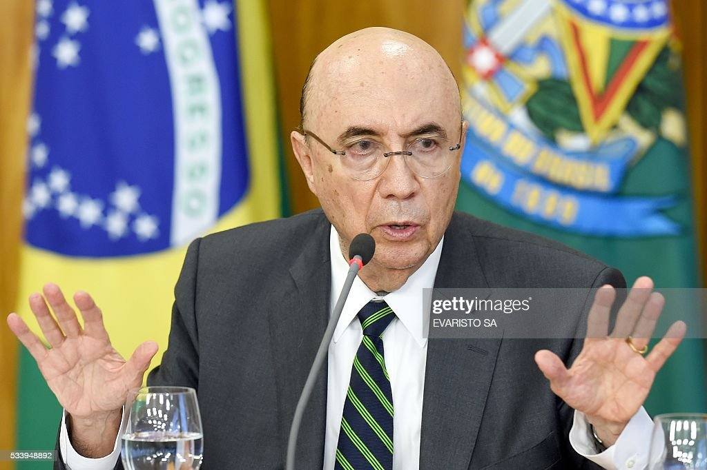 Brazilian Finance Minister Henrique Meirelles speaks at a press conference to explain the government's economic measures aimed at curbing public spending and reviving growth, in the Planalto Palace, the seat of government, in Brasilia on May 24, 2016. / AFP / EVARISTO SA