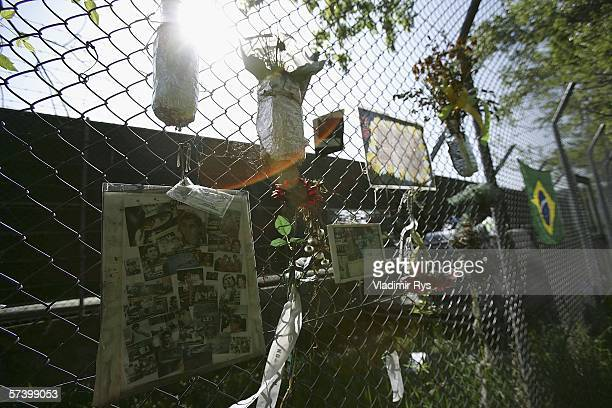 Brazilian flag and messages from the fans are seen hanging on the fence nearby the place of crash accident of Ayrton Senna of Brazil during the...